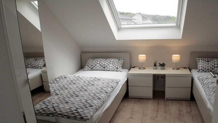 Bed at Pellenzblick Apartments - Citybase Apartments