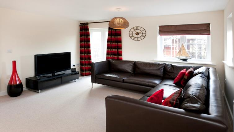 Living area at DBS The Coach House Apartment - Citybase Apartments