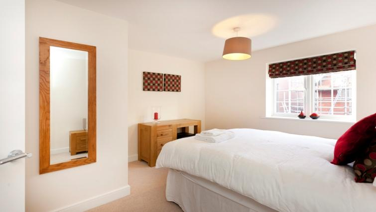 Bedroom at DBS The Coach House Apartment - Citybase Apartments