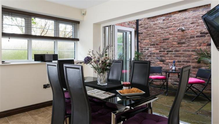 Dining area at The Light Well Apartment - Citybase Apartments