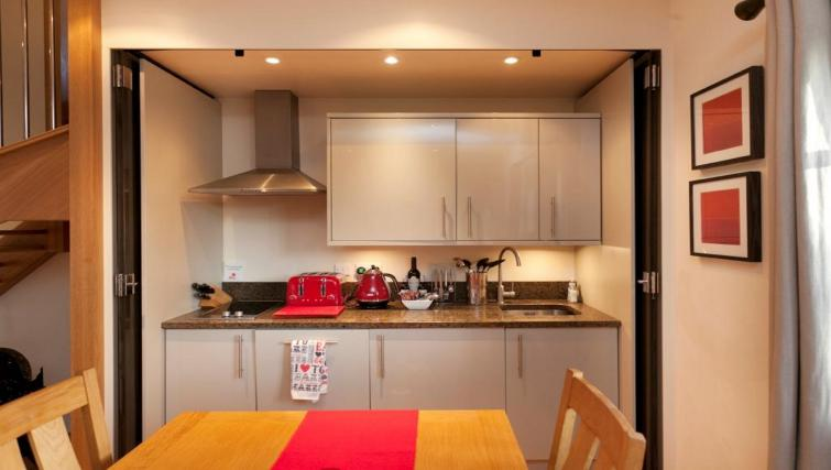 Kitchen at DBS The Delven Apartment - Citybase Apartments