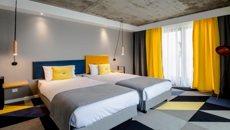 Twin beds at Lwowska 1 Aparthotel - Citybase Apartments