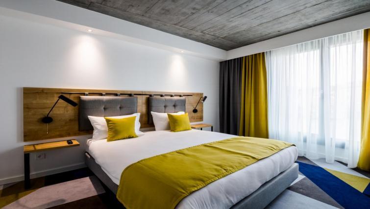 Bedroom at Lwowska 1 Aparthotel - Citybase Apartments