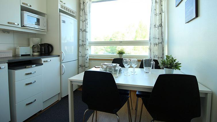 Dining area at Vähäntuvantie Apartment - Citybase Apartments