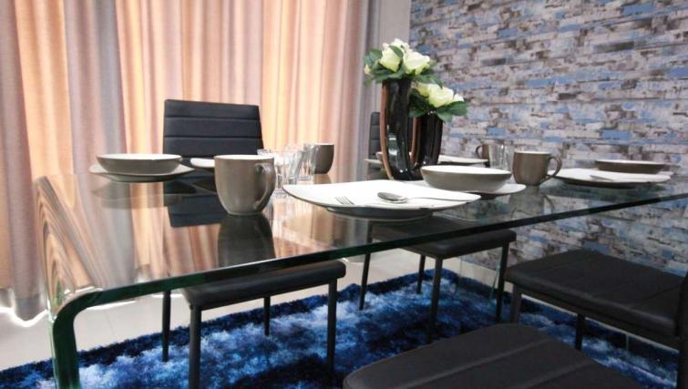 Dining area at Harvia Suites - Citybase Apartments