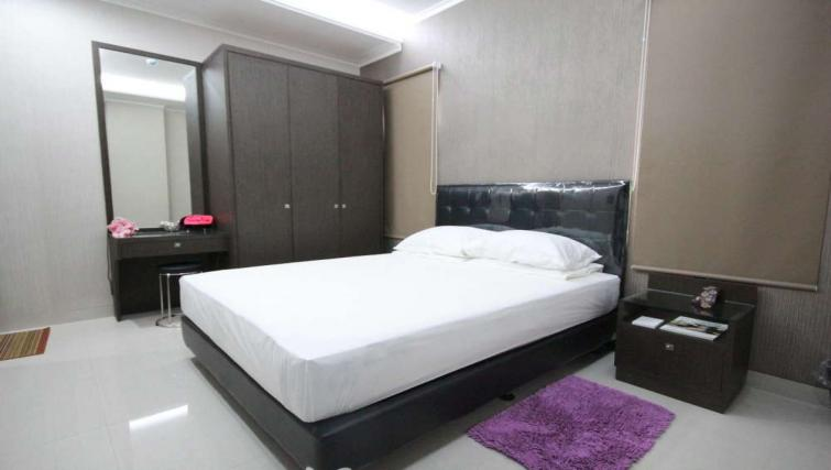Double bedroom at Harvia Suites - Citybase Apartments
