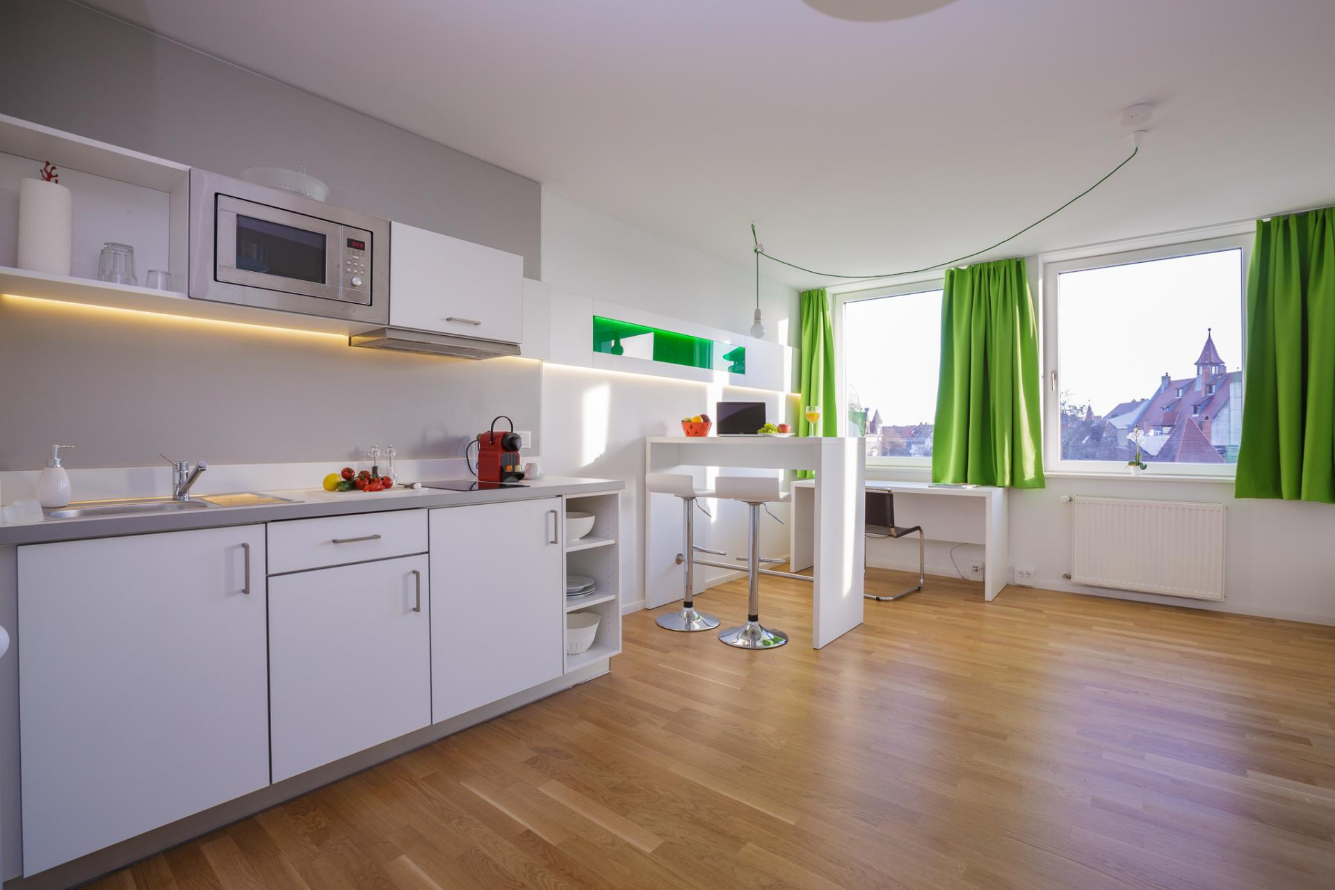 Spacious living area and kitchen at Brera Am Plaerrer 2 Apartments - Citybase Apartments