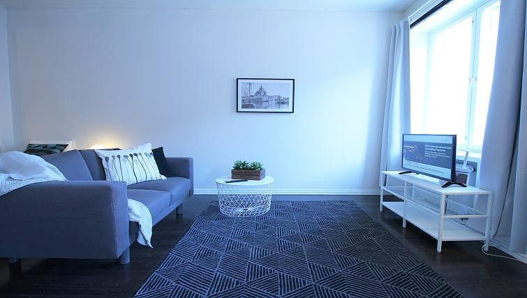 Living room at Mechelininkatu Apartment - Citybase Apartments