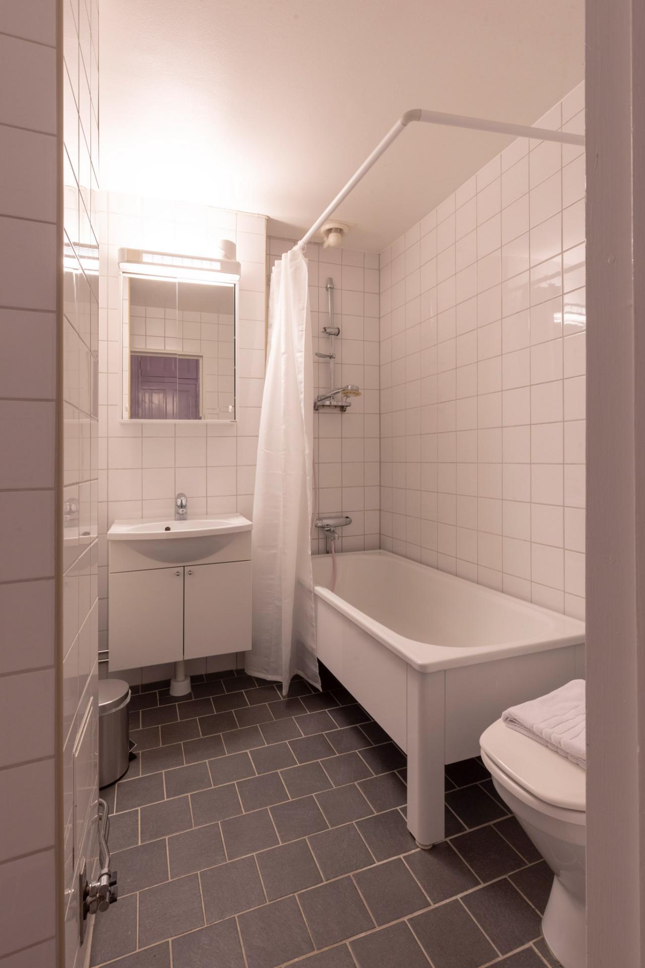 Modern bedroom at Kocksgatan Apartments - Citybase Apartments