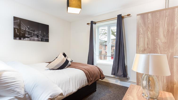 Bed at Pride Apartments - Citybase Apartments