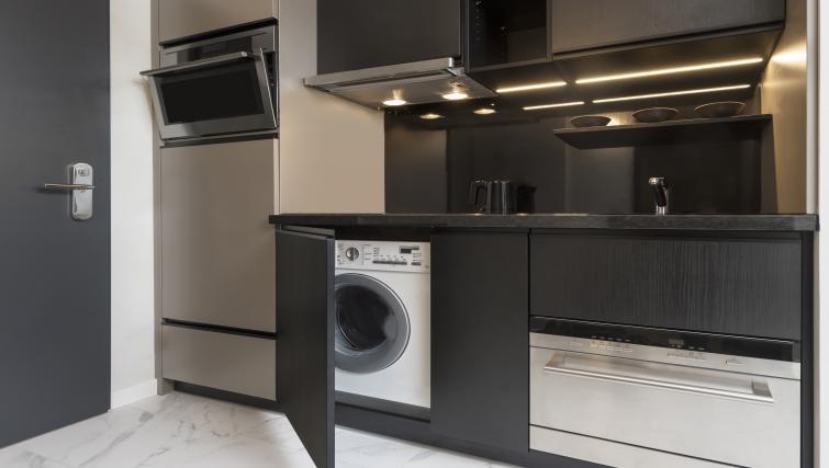 Kitchen at Adina Apartment Hotel Frankfurt Westend - Citybase Apartments