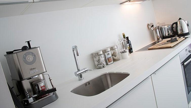 Small kitchen at Staying Cool at The Rotunda - Citybase Apartments