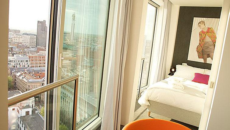 Bed and views at Compact bedroom in Staying Cool at The Rotunda - Citybase Apartments