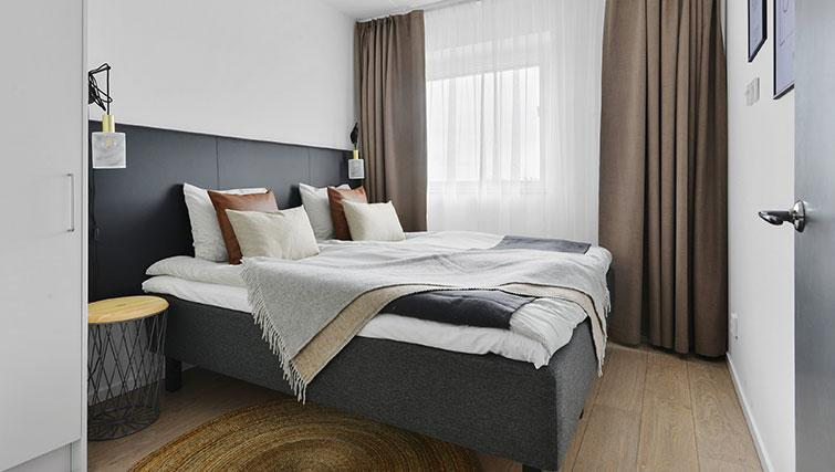 Bedroom at Stockholm South Apartments - Citybase Apartments