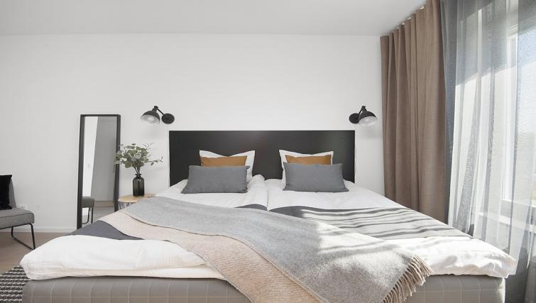 Clean bedroom at Stockholm South Apartments - Citybase Apartments