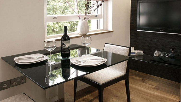 Compact dining area in Space Apartments - Citybase Apartments