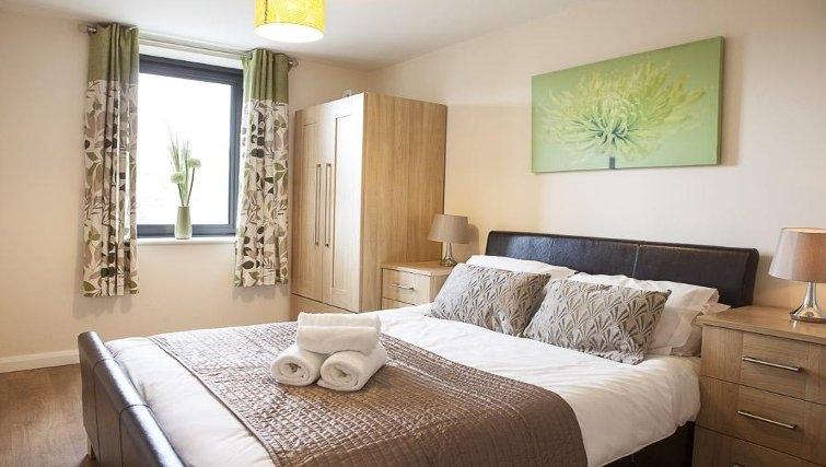 Cozy bedroom in The Cheltenham Plaza Apartments - Citybase Apartments