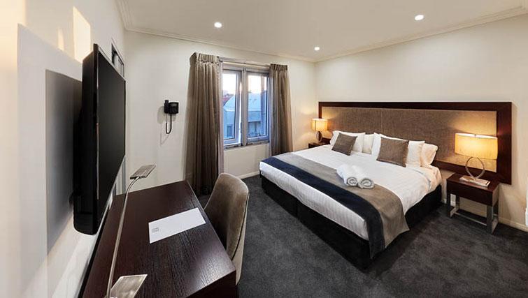 Bed at Attika Apartments - Citybase Apartments