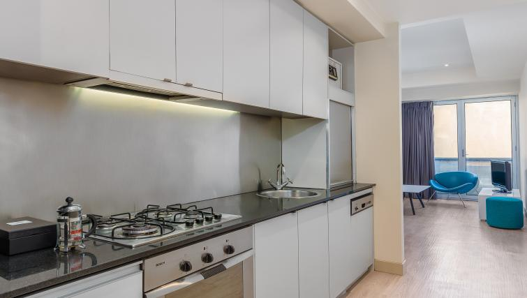Kitchen facilities at the BreakFree on Collins Apartments - Citybase Apartments