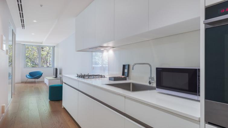 Kitchen at the BreakFree on Collins Apartments - Citybase Apartments