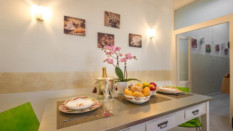 Dining table at Residenza Diaz Apartment - Citybase Apartments