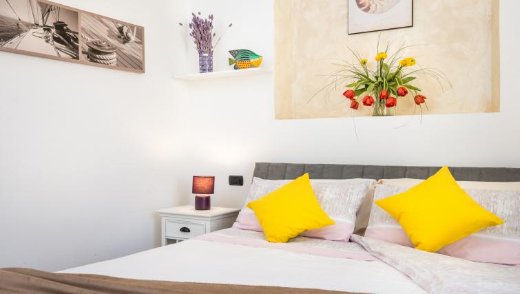 Bright bedroom at Residenza Diaz Apartment - Citybase Apartments