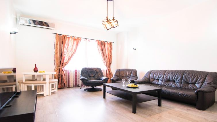Chairs at Calea Victoriei Apartment - Citybase Apartments