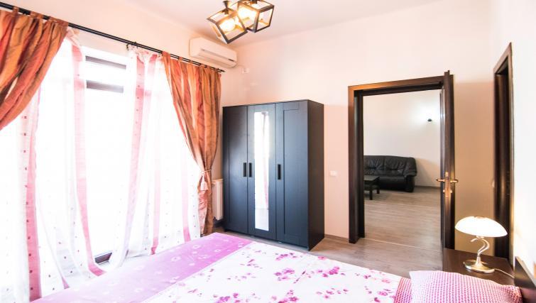 Double bed at Calea Victoriei Apartment - Citybase Apartments