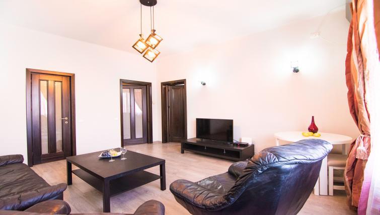 Living area at Calea Victoriei Apartment - Citybase Apartments