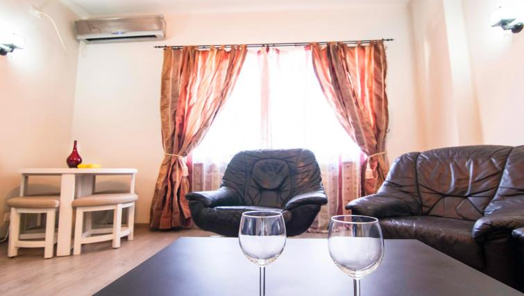 Table at Calea Victoriei Apartment - Citybase Apartments
