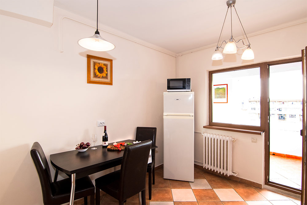 Dining area at Odeon Apartment, Old Town, Bucharest - Citybase Apartments