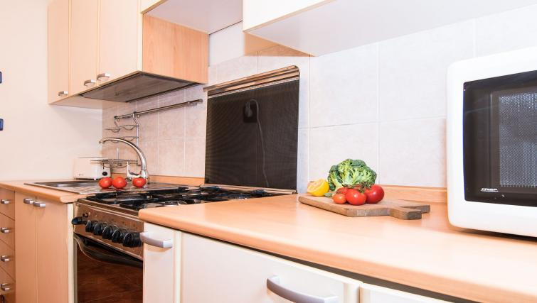 Equipped kitchen at Balcescu Apartment - Citybase Apartments
