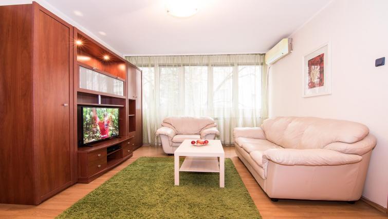 Sofas at Balcescu Apartment - Citybase Apartments