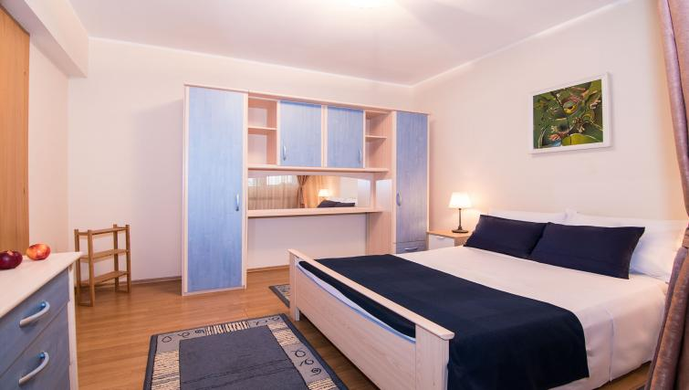 Double bed at Balcescu Apartment - Citybase Apartments