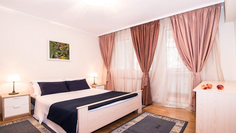 Bedroom at Balcescu Apartment - Citybase Apartments