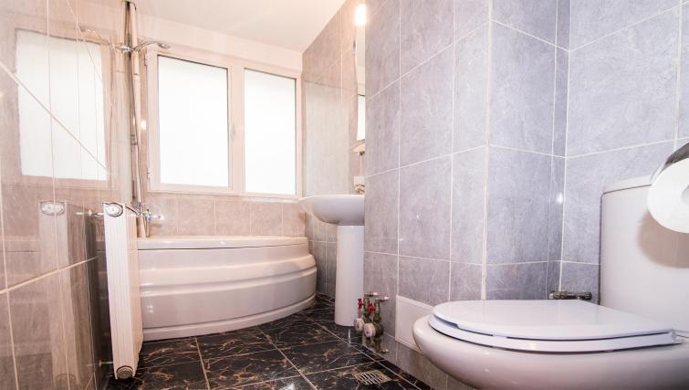 Bathroom at Balcescu Apartment - Citybase Apartments