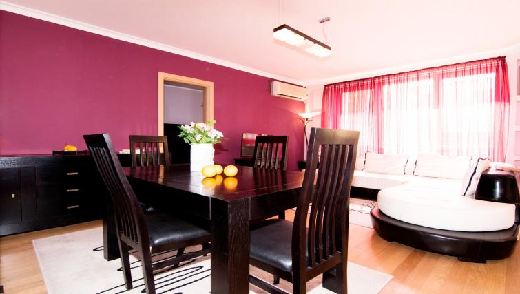 Dining area at Sala Palatului Apartment - Citybase Apartments