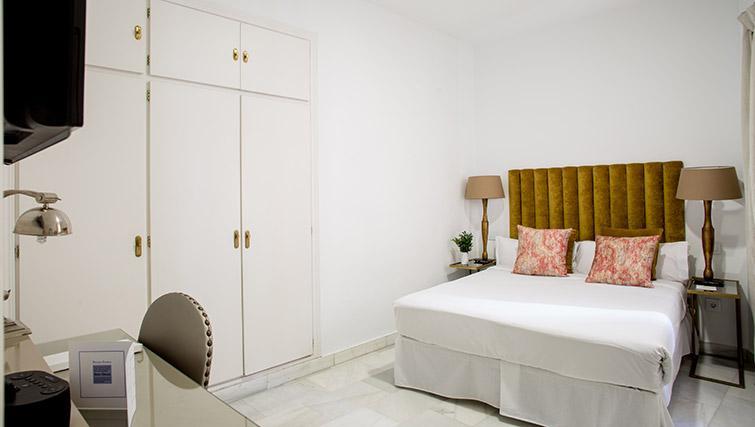 Bed at 11th Principe Apartments - Citybase Apartments