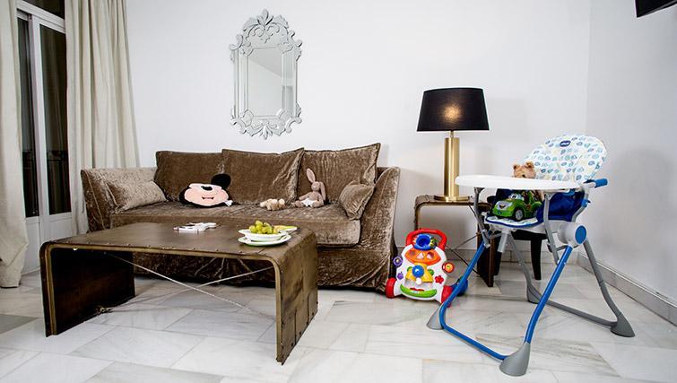 Sofa at 11th Principe Apartments - Citybase Apartments
