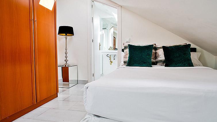 Stylish bedroom at 11th Principe Apartments - Citybase Apartments