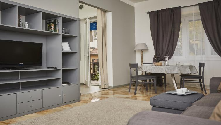 TV at Papiniano Apartment - Citybase Apartments