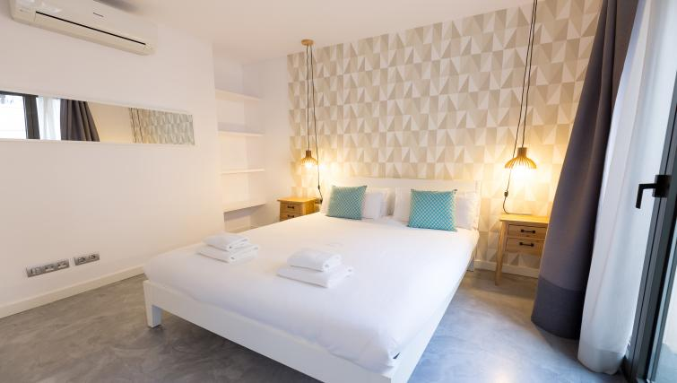 Double bed at Park Guell Apartments - Citybase Apartments