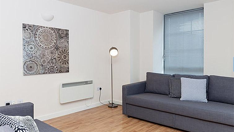Living space at Hicking Dye Works Apartment - Citybase Apartments