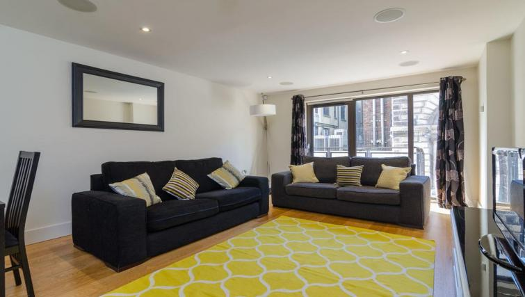 Living area at Custom House Square Apartment - Citybase Apartments