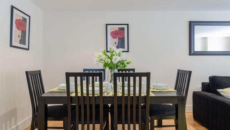 Dining area at Custom House Square Apartment - Citybase Apartments