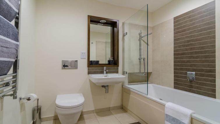 Bathroom at Custom House Square Apartment - Citybase Apartments