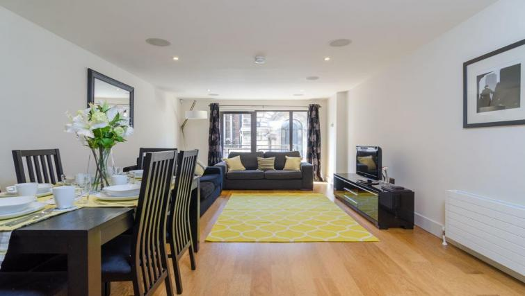 Living space at Custom House Square Apartment - Citybase Apartments
