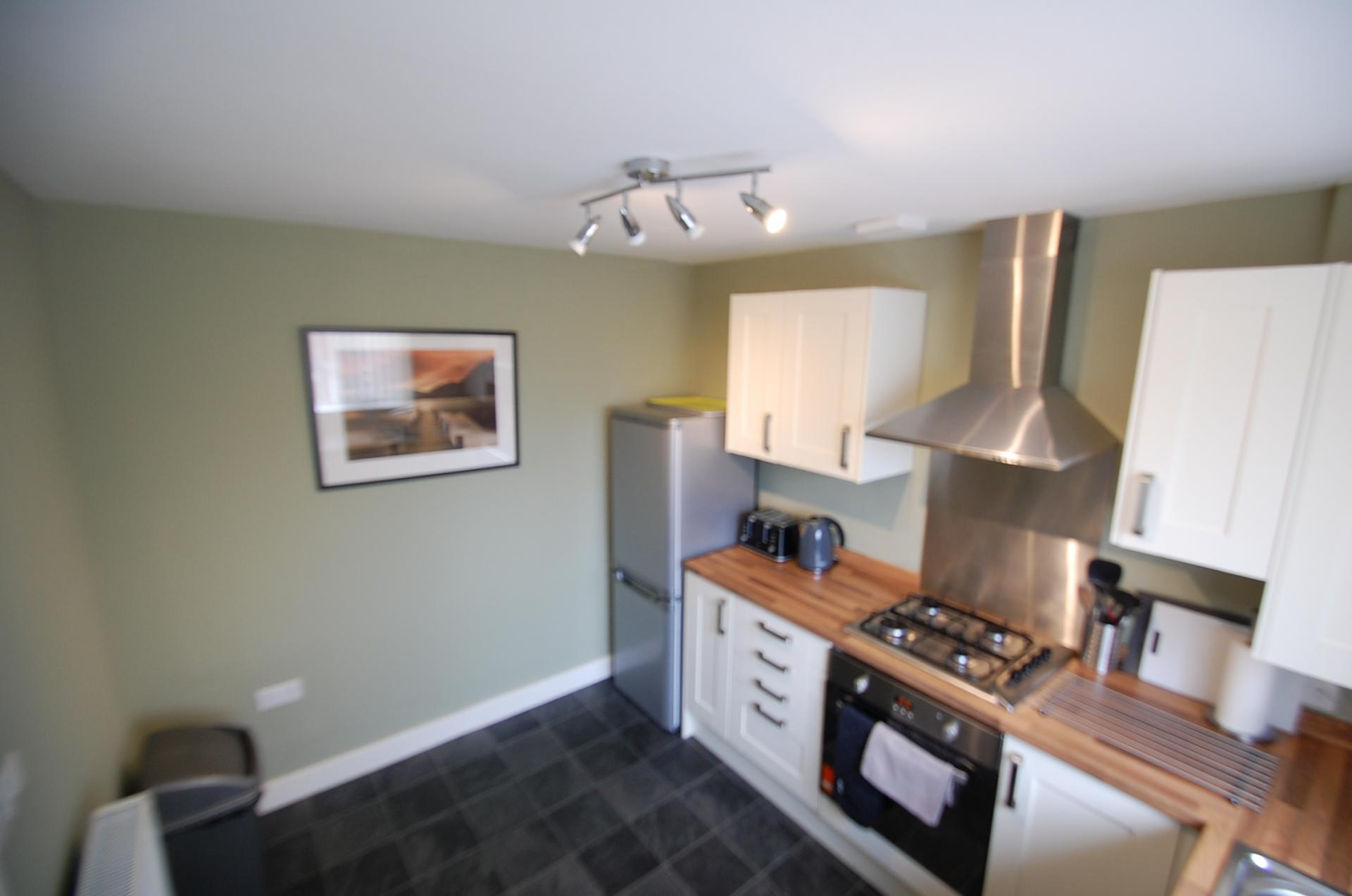 Modern kitchen at Cosy Dragon @ Tanglewood House - Citybase Apartments