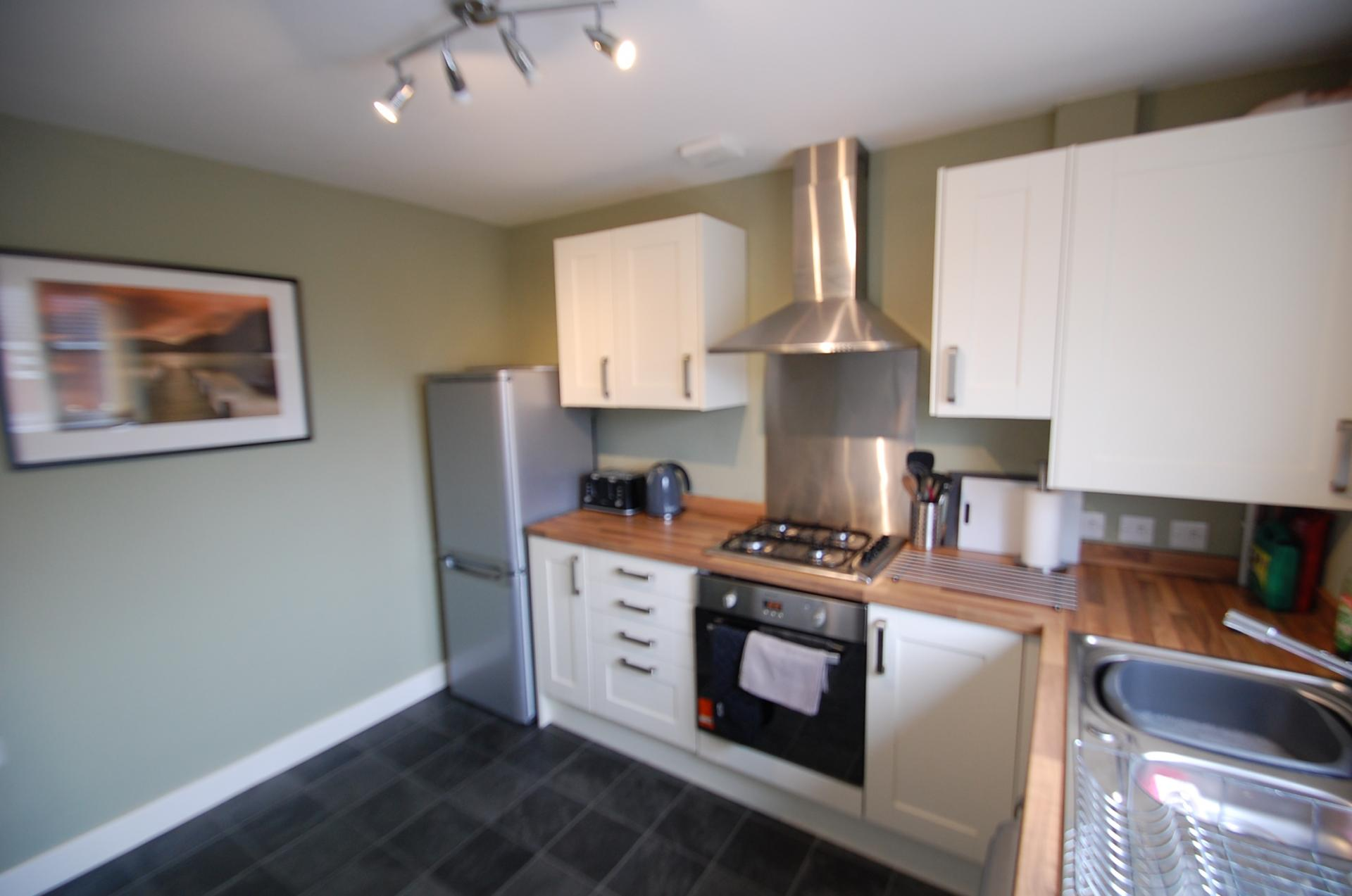 Equipped kitchen at Cosy Dragon @ Tanglewood House - Citybase Apartments