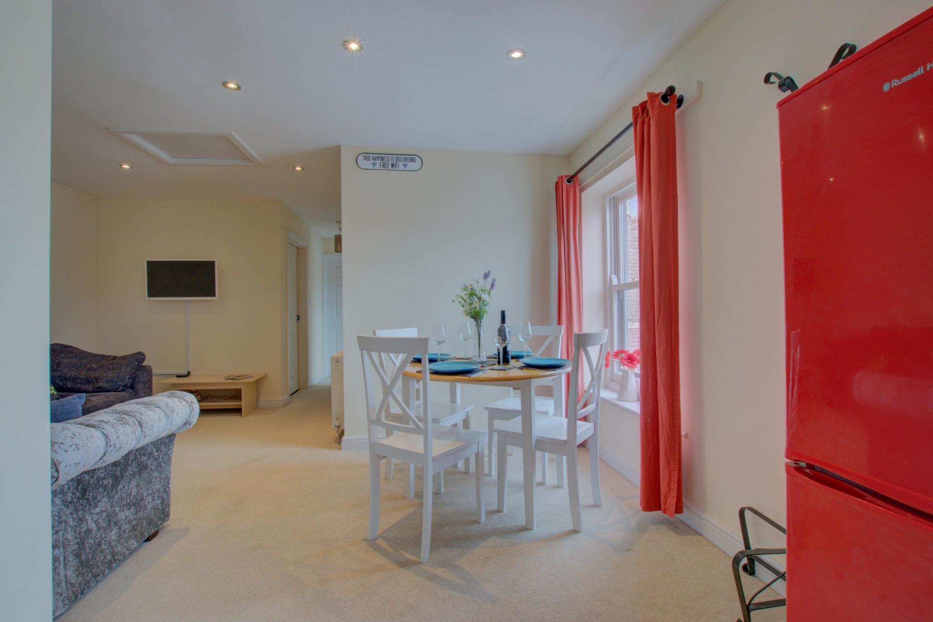 Open-plan living area at Sherlock Holmes Apartments - Citybase Apartments